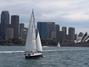 A Sailboat on the waters of Sydney Harbour .